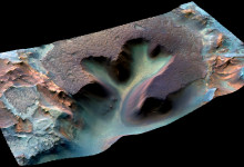 Example of a fully-simulated infrared-colour and 3D CaSSIS image of the Nili Fossae region on Mars at 4.6 meter per pixel. The Nili Fossae region is thought to be one of the potential source regions for transient methane gas in the Martian atmosphere that the ExoMars Trace Gas Orbiter is hoping to detect, characterise and determine its origins. Based on previous studies, the Nili Fossae region is known to possess rocks and deposits that contain a green mineral called serpentine. The formation of this mineral is known to commonly produce methane gas as a byproduct.  The image equates to approximately 6 kilometres in width.
